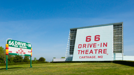 CARTHAGE, MO USA - MAY 7, 2013  Historic 66 Drive-in Theatre and neon sign, on Route 66  National Register of Historic Places