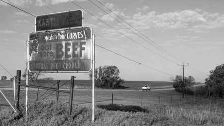 YUKON, OK USA - MAY 8, 2013  Historic Kastl Farms sign   Watch Your CURVES  eat more BEEF , on Route 66
