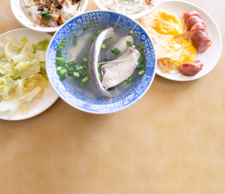 Photo for Milkfish skin soup, distinctive Taiwan delicacy food in Tainan. Famous meal set for lunch or breakfast with vegetable, top view, copy space, close up - Royalty Free Image