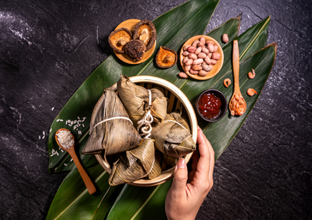 Photo for Zongzi, delicious fresh hot steamed rice dumplings in steamer. Close up, copy space, famous asian tasty food in dragon boat duanwu festival - Royalty Free Image