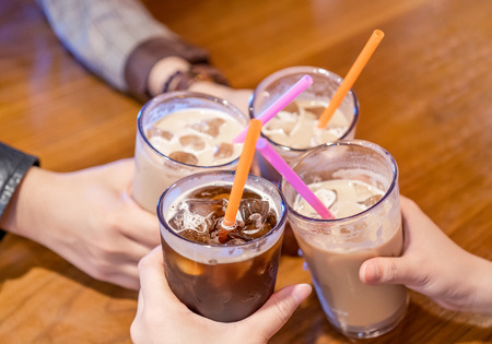 Foto de Party concept, girl with friends hold coffee cups and say cheers happy hangout together in cafe, lifestyle, copy space, top view, close up - Imagen libre de derechos