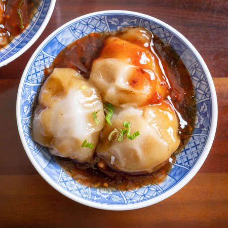 Photo for Bawan (Ba wan), Taiwanese meatball delicacy, delicious street food, steamed starch wrapped round shaped dumpling with pork inside, close up, copy space - Royalty Free Image
