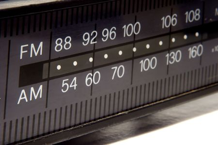 closeup on old AM/FM radio display