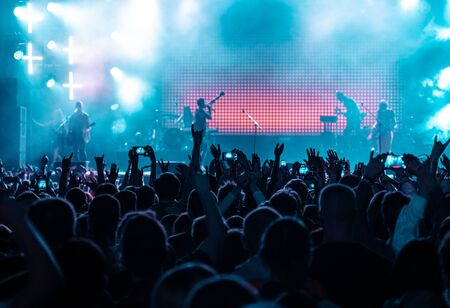 Photo pour Audience crowd people raise hands enjoy live music festival concert event. - image libre de droit