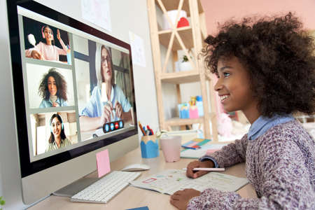 Photo pour African kid girl distance learning during online group class with teacher. - image libre de droit