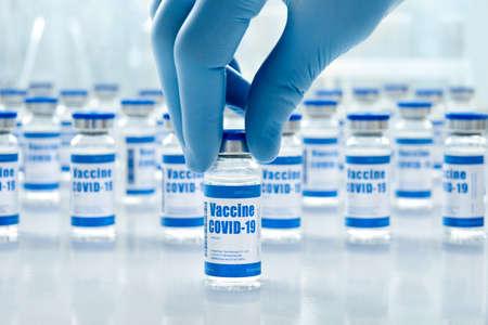 Photo pour Covid 19 vaccine vial bottles, corona virus cure manufacture concept. - image libre de droit