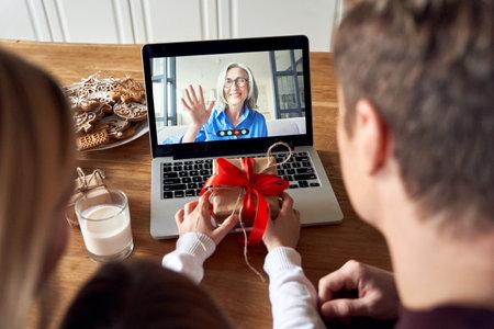 Photo pour Happy family video calling grandparent on laptop screen having virtual party. - image libre de droit