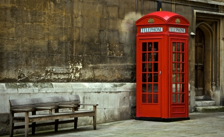 British Phone Booth With Weathered Wooden Bench