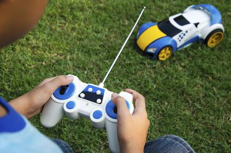 Remote control toy car with a boy.