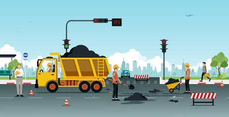 Photo for Workers are repairing road surfaces with traffic lights. - Royalty Free Image