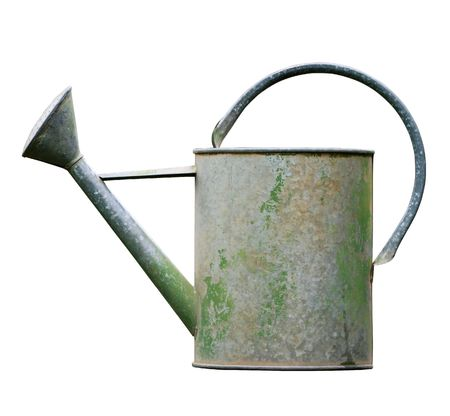 Aged metalic watering can isolated on white background