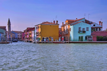 Colorful island Burano. View from one boat in the lagoon