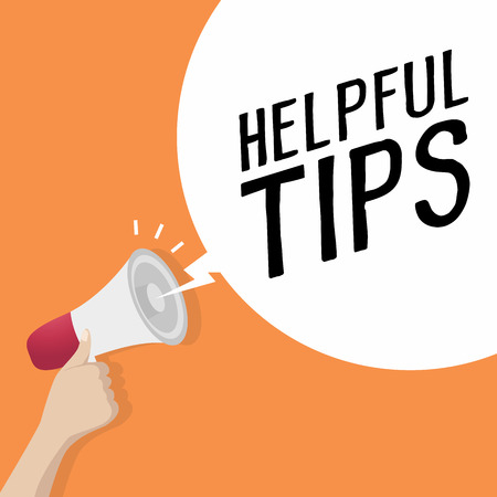 Hand holding loudspeaker or megaphone with speech bubble HELPFUL TIPS. announcement concept. vector