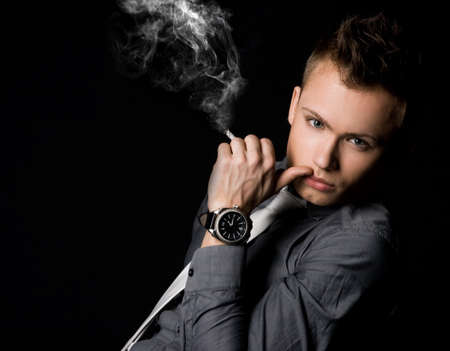 attractive businessman with a cigarette