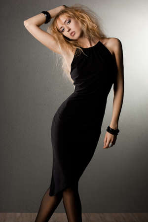 beautiful fashionable woman in black dress