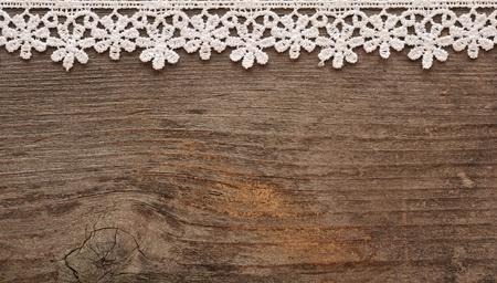 Photo pour wooden background with white lace frame  - image libre de droit