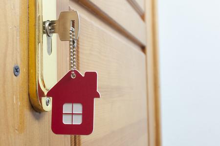 Photo pour A key in a lock with house icon on it - image libre de droit