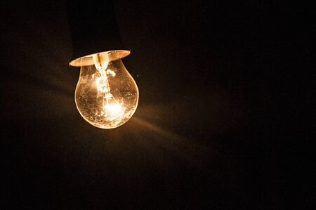 Photo for Electric light bulb on the dark background - Royalty Free Image
