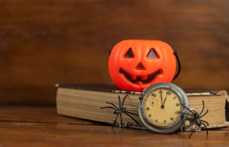 Foto de Black plastic spider sitting on pocket watch. Happy halloween - Imagen libre de derechos