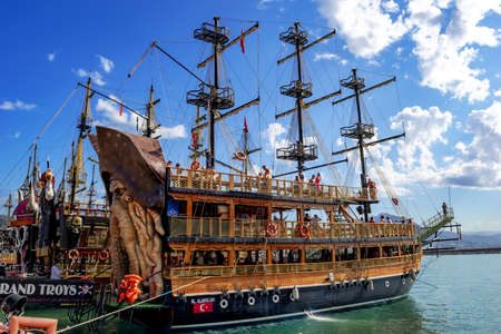 Turkey, Alanya - October 22, 2020: Pirate ship Bl.Alanya 241 with people on deck parked in Alanya Yat Limani port. Large authentic wooden schooner - transport for tourist cruises in a Turkish resort