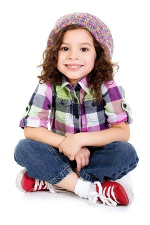 Stock image of happy female preschool age child sitting over white background
