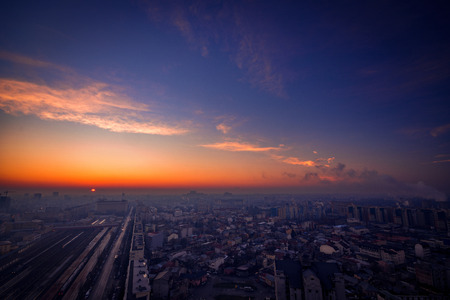 Sunrise scene above the city with city lights and traffic lights and illuminated buildings in Bucharest Romania from Basarab overpass