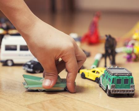 Foto de children playing toys on floor at home, little hand in mess, free education - Imagen libre de derechos