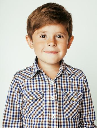 Photo pour little cute real boy on white background gesture smiling close up. sweet kid - image libre de droit