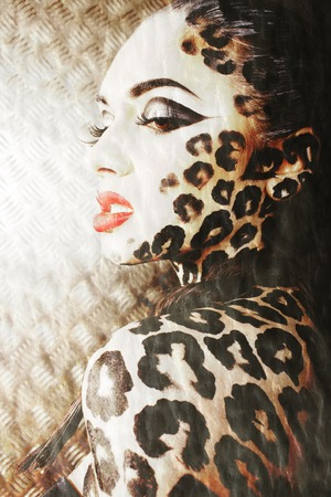 young sexy woman with leopard print make up all over body, cat bodyart closeup