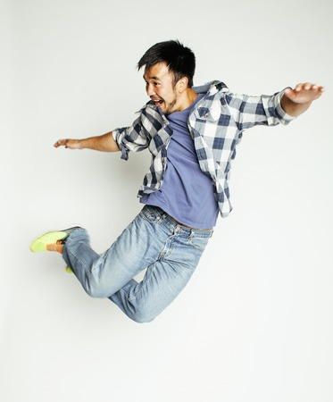 Photo for young pretty asian man jumping cheerful against white background, lifestyle people concept, supeman flying - Royalty Free Image