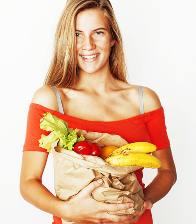 young pretty blond woman at shopping with food in paper bag isol