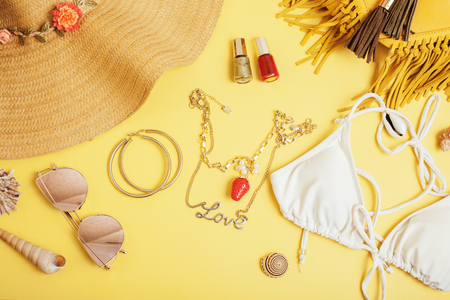 diverse travel girlish stuff on colorful background blue and yellow, nobody tourism lifestyle concept