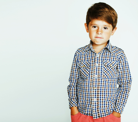little cute real boy on white background gesture smiling close u