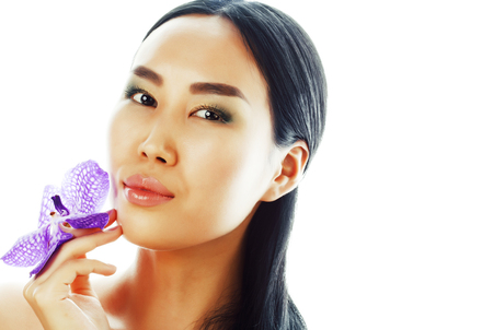 Photo for young pretty asian woman with flower purple orchid close up isolated - Royalty Free Image