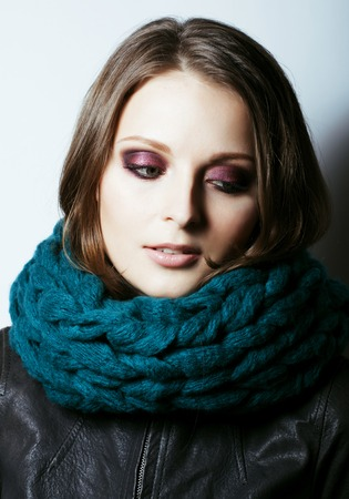 Photo pour young pretty real woman in sweater and scarf all over her face - image libre de droit