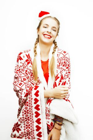 Photo pour young pretty happy smiling  woman on christmas in santas red hat - image libre de droit