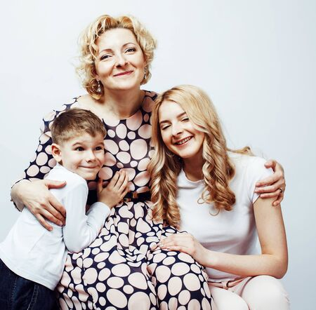 Photo pour happy smiling blond family together posing cheerful on white background - image libre de droit