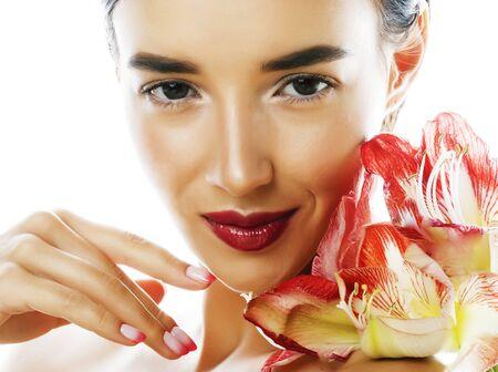 Foto de young pretty brunette real woman with red flower amaryllis - Imagen libre de derechos