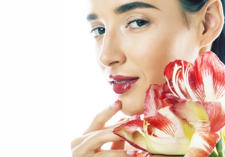 Photo for young pretty brunette real woman with red flower amaryllis close up isolated on white background. Fancy fashion makeup, bright lipstick, creative Ombre manicured nails - Royalty Free Image