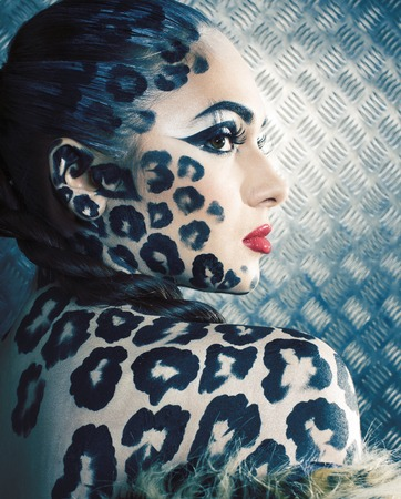 Photo pour young sexy woman with leopard make up all over body, cat bodyart print close up - image libre de droit