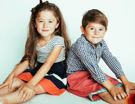 Photo pour little cute boy and girl hugging playing on white background, happy smiling family, lifestyle people concept close up - image libre de droit
