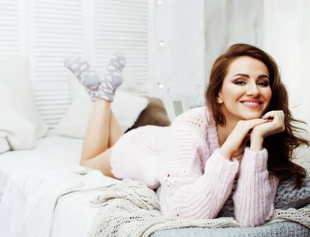 Photo pour young pretty brunette woman in her bedroom sitting at window. lifestyle people concept - image libre de droit