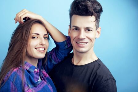 Photo pour happy couple together posing cheerful on blue background , guy and girl students together friends - image libre de droit
