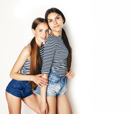 Photo pour best friends teenage girls together having fun, posing emotional on white background, besties happy smiling, lifestyle people concept - image libre de droit