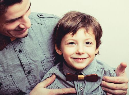 Photo for father with son in bowties on white background, casual look - Royalty Free Image