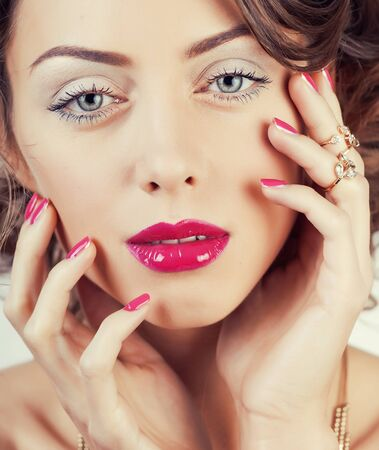 Photo pour beauty young luxury woman with jewellery, rings, nails close up on white - image libre de droit