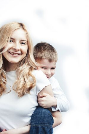 Photo for young modern blond curly mother with cute son together happy smiling family posing cheerful on white background, lifestyle people concept, sister and brother friends - Royalty Free Image
