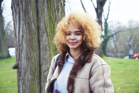 Photo pour young cute blond african american girl student smiling in green park, lifestyle people concept - image libre de droit