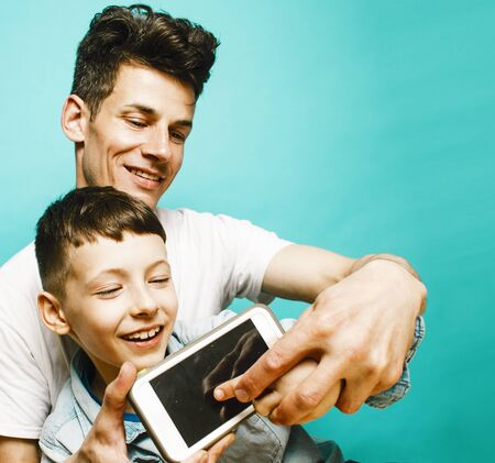 Photo for young pretty man model with little cute son playing together, lifestyle modern people concept, family male - Royalty Free Image