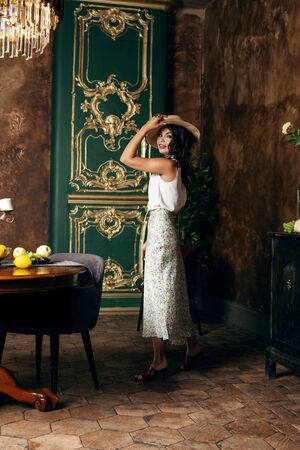 Photo pour young pretty rich italian woman in golden luxury room interior, elegant styled hotel, people on vacation - image libre de droit